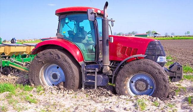 Steckengebliebener Traktor Schlupf